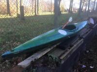 Green single sit in kayak with oar