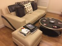 E Seater sofa, Glass coffee table and Recliner chair with stool nearly new