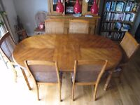 Extending dining table, 150 cm - 195 cm X 107 cms. and six chairs.