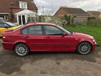 BMW 320D imola red