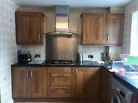 Kitchen units and black worktop