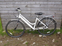 ladies town bike. used four times 5 years ago. basket and panniers.