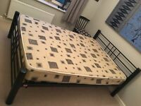 Double Black metal bedstead with sprung wooden slats and mattress in excellent condition