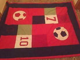 Football throw and matching mat.