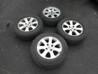 PEUGEOT ALLOY WHEELS WITH NEW TYRES FITMENT 185/65/15..PICK UP ONLY