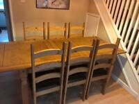 Pine solid extendable table with 6 chairs. Very good condition