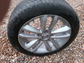 SILVER alloy wheel and good tyre £25