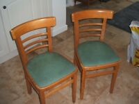 TWO WOODEN KITCHEN CHAIRS WITH GREEN SEAT PADS