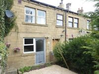 A charming two bedroom through terrace cottage situated close to Pudsey town centre amenities
