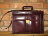 Unisex leather briefcase in quality oxblood colour leather