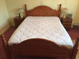 Solid pine king size bed.