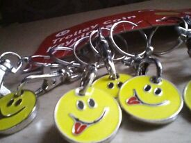 7 smiley face trolley coin keyrings