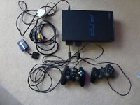 PS2 Games Console with hand controllers and leads plus MADCATZ link
