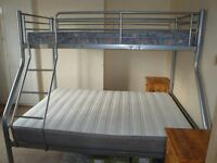 Double bed with single bunk.