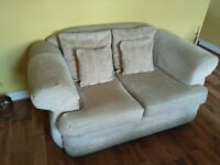 Lovely two person cream sofa