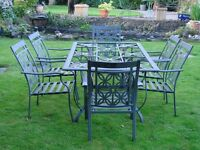 garden table and six chairs made of metal glass missing and cushions