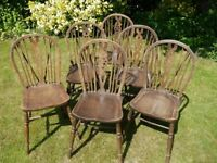 6 (six) Traditional Wooden Wheel back chairs.
