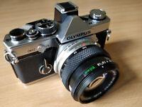 OM2 film camera system (35mm) - with four Olympus Zuiko lenses, flashgun, UV and polarising filters.