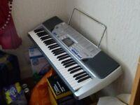 Casio CTK-496 KEYBOARD & Stand. Hardly used, 61 standard size keys, 5 octaves,