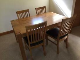Oak dining table (extendable) and four chairs