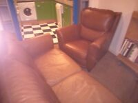 Brown two seater leather sofa and matching armchair. In good condition. Collect only