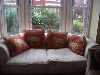 Comfortable three seater cream fabric couch/sofa