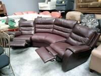 Dark brown leather curved corner sofa reclining
