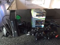 Xbox 360 250GB, with Kinect, 18 games, 4 Venom wireless controllers and charge pack, headset