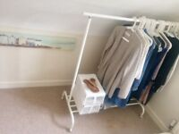 New condition! Clothes rack. Sleek, fits anywhere, and very practical. Selling 2 of them!