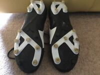 Hardly worn, Puma plastic studded football/ rugby boots size 4