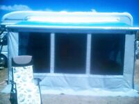 Motorhome awning front wall