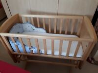 Swinging crib. Excellent condition. Ive got spare mattress. Crib bumper included