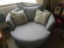 DFS swivel cuddle chair