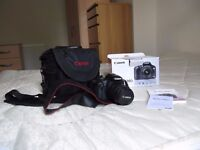 Canon 500D with 18-50mm lens and bag