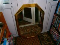 two large gold plated mirrors