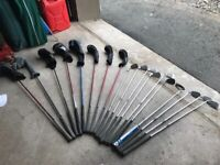 Complete set of golf clubs with power caddy