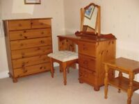 Bedroom suite in antique finish pine: Dressing Table w Mirror & Stool, 7 drawer chest & b'side table