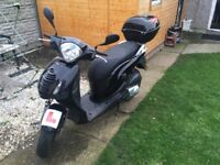 Black Honda Scooter pes 125A