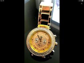 Ladies watch gold coloured with diamanté bezel