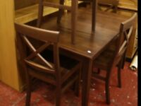 Modern extending dining table and four bar back chairs