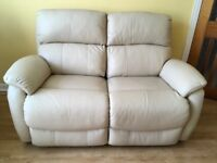 Electric, 2-seater cream leather sofa for sale. NEW
