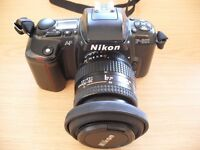 Nikon F-601 SLR Camera with multiple lenses, flash unit, exposure meter, instructions & case