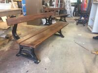 Heavy duty summer seat with solid walnut seating and cast iron legs