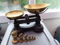Old fashioned weighing scales . Brass and black cast iron