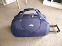 Nearly new navy lightweight trolley bag with wheels