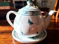 Vietnamese teapot and tea cup set