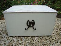 Wood storage chest (horse shoe motif).