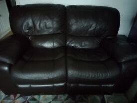 Brown Leather Reclining 2 Seater Sofa in good condition. W70ins x D40ins x H 38ins
