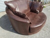 Stunning Brand New brown very large (127cm) swivel cuddle love chair. Can deliver