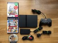 PlayStation 2 slim console with grand theft auto games. Ps2